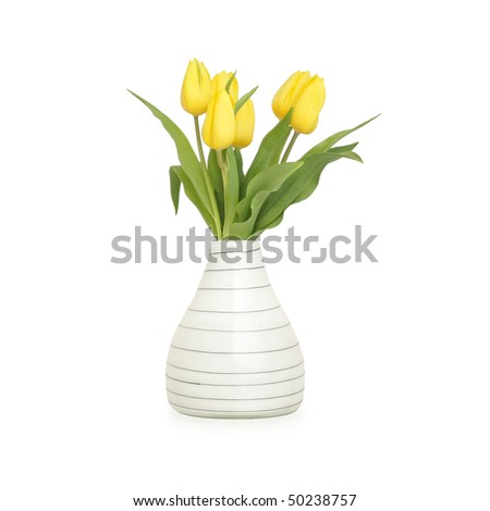 Yellow tulips in vase, isolated on white - stock photo