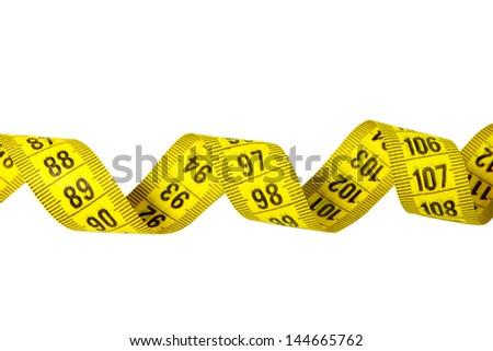 Yellow twirled measuring tape isolated on white - stock photo