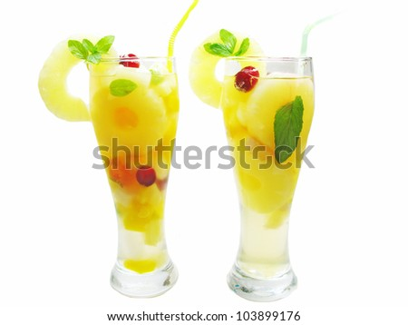 yellow two fruit punch cocktail drinks with pineapple lemon and ice