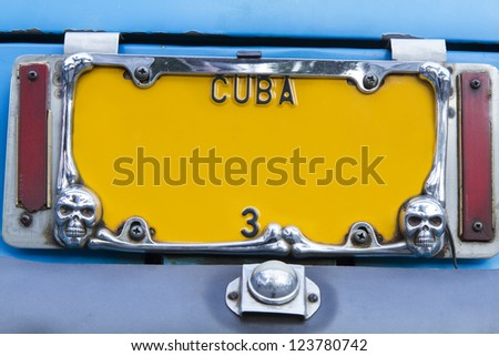 Yellow vintage numberplate on Cuba - stock photo