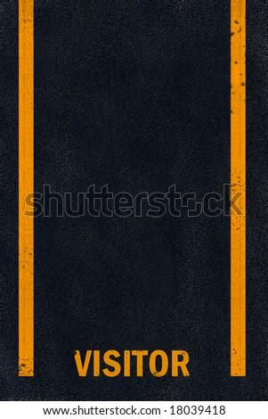 Yellow visitor parking marking on black fresh asphalt pavement - stock photo