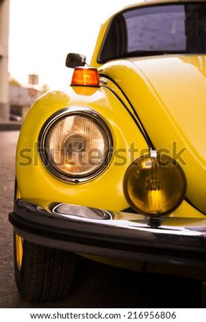 Yellow Volkswagen beetles headlight. Izmir Turkey 10 September 2014 .The Volkswagen Beetle, was an economy car produced by the German auto maker company Volkswagen. - stock photo