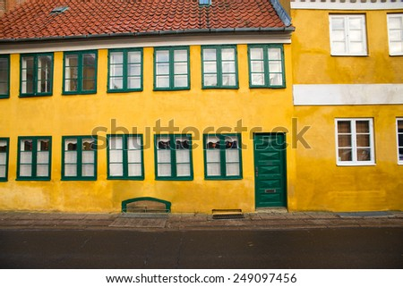 yellow wall of an old house - stock photo