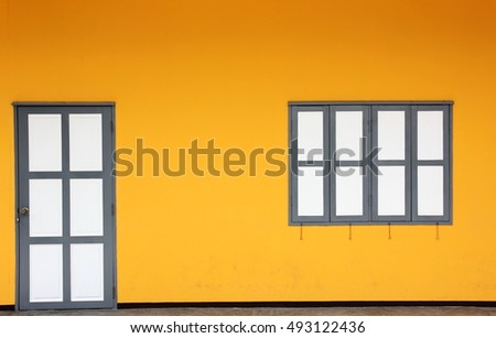 yellow wall with gray-white  window and door
