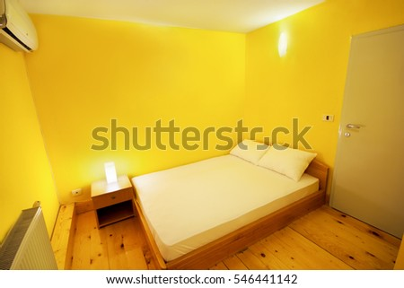 Yellow walls apartment room or hotel en suite with wooden floor, toilet cabin, bed room in a boat deck