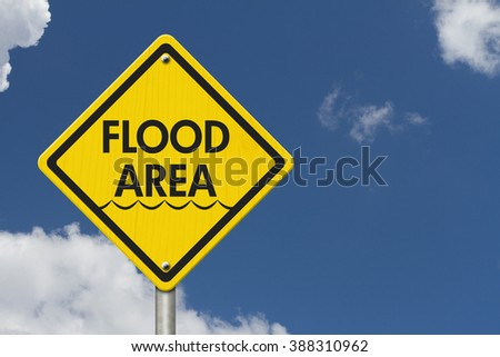 Yellow Warning Flood Area Highway Road Sign, Red, Yellow Warning Highway Sign with words Flood Area with sky background - stock photo