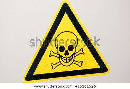 Yellow Warning Sign with Skull - stock photo