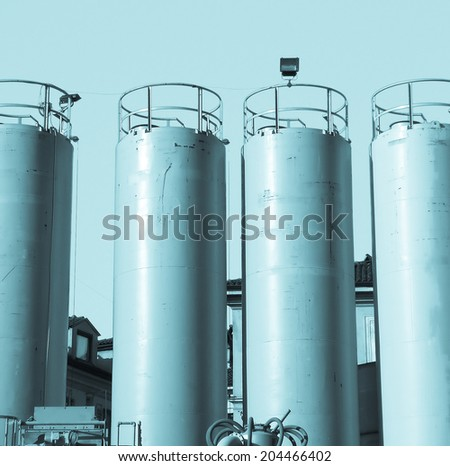 Yellow water tanks over a blue sky - cool cyanotype