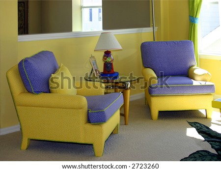yellow welcoming sitting area in upscale home - stock photo