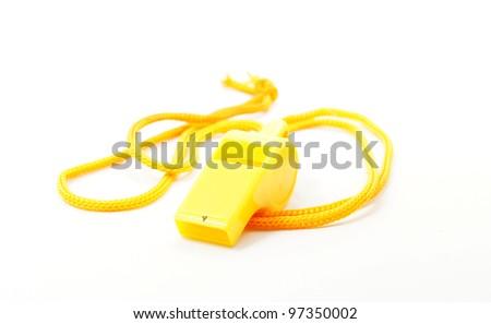 yellow whistle on white background - stock photo