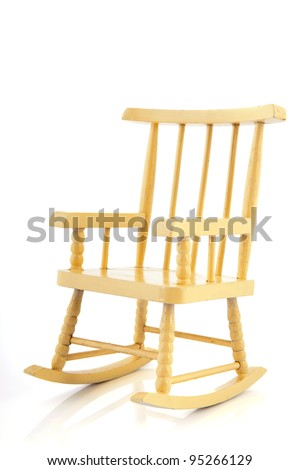 Yellow wooden rocking chair isolated over white background