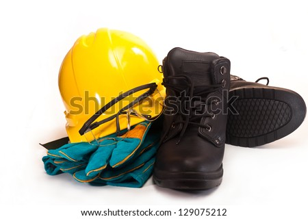 Yellow working hard hat, goggles, gloves and work boots on a white background - stock photo