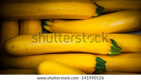 Yellow zucchini at farmers market in Provence. Shaded angles. - stock photo