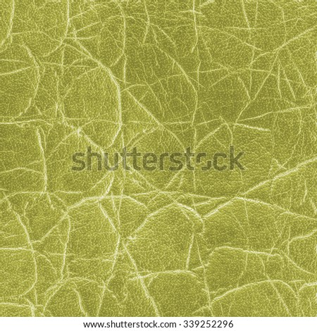 yellowish-green artificial snake skin texture  closeup - stock photo