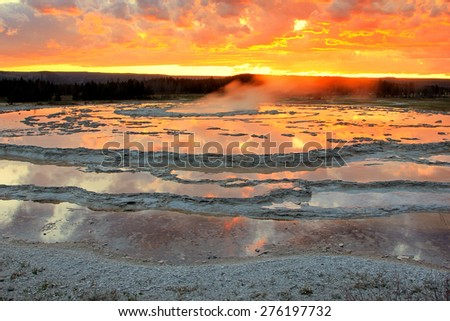 Yellowstone geyser sunset, Wyoming, USA. - stock photo