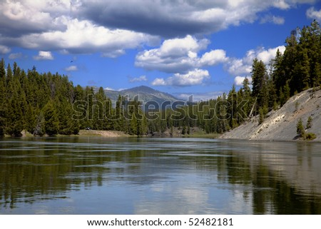 Yellowstone River in Yellowstone National Park with blue sky and clouds - stock photo