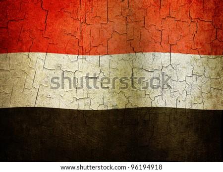 Yemen flag on a cracked grunge background - stock photo