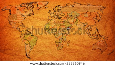 yemen flag on old vintage world map with national borders - stock photo