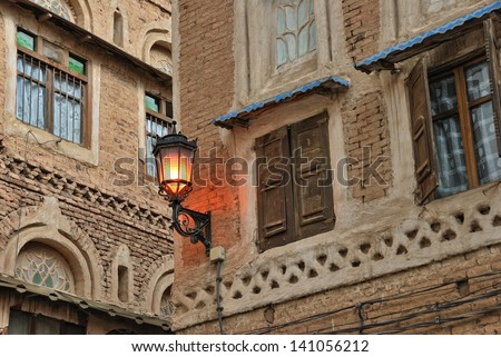 Yemen, Sanaa. Lighting street torch on the ancien house in the old town - stock photo