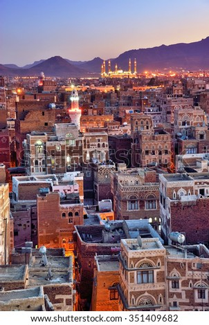 Yemen. Sunrise in the old city of Sanaa. Inhabited for more than 2.500 years at an altitude of 2.200 m, the Old City of Sanaa is a UNESCO World Heritage City now destroyed by the civil war - stock photo