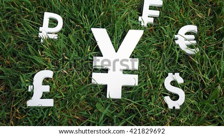 Yen exchange currency on a grass background - stock photo
