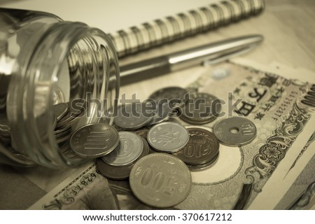 yen notes and yen coins for money concept background - stock photo