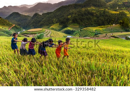 YENBAI - SEP 25 : Undefined Vietnamese Hmong children are playing in rice terrace on september 25, 2015 at mam xoi of mu cang chai district,Yenbai province, northwest of Vietnam. - stock photo