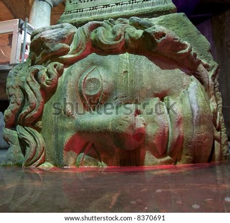 Yerebatan underground water cistern showing Medusa head column support (Istanbul) - stock photo