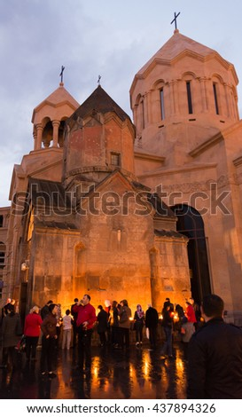 YEREVAN, ARMENIA - 04 APRIL 2015: Believers gather around the Katoghike complex in Ierevan during the armenian orthodox Easter celebrations to light candles and pray.
