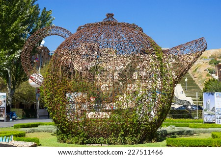 YEREVAN, ARMENIA - OCTOBER 12, 2013: Modern art iron teapot statue near the Yerevan Cascade. The Cascade is a giant stairway and one of main landmarks in city - stock photo