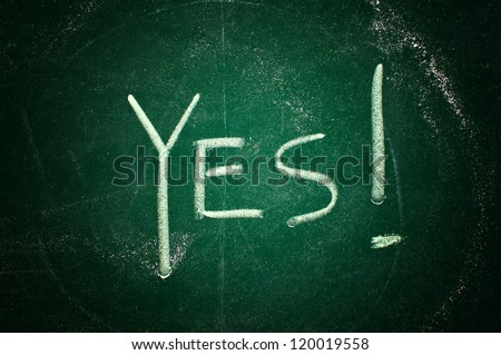 Yes concept; word written with chalk on the green board