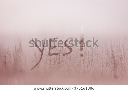 Yes written on foggy window background. Positive agreement sign - stock photo