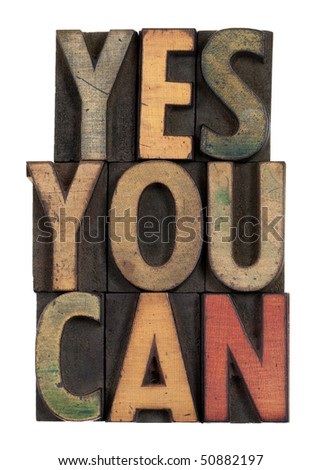 Yes you can - motivational slogan in vintage letterpress wooden type, stained by ink, isolated on white - stock photo