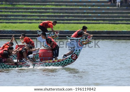 YILAN TAIWAN - JUNE 1: flag fetchers are preparing to snatch the flag. The Dragon Boat Festival on the Dongshan River on June 1, 2014 in Yilan - stock photo