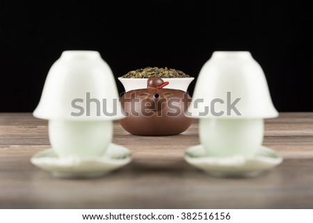 Yin-Yang tea set of cups with teapot on wooden table. Tea ceremony