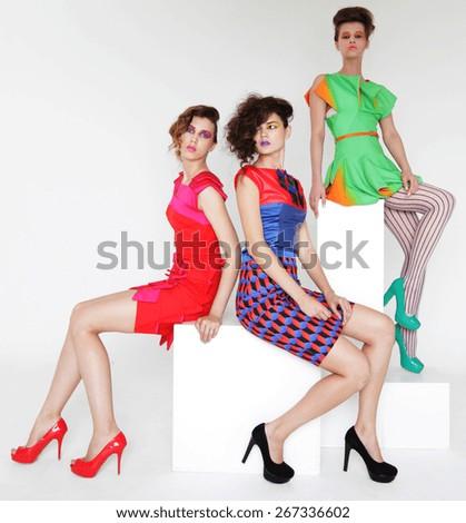 yioung fashion models studio shot - stock photo