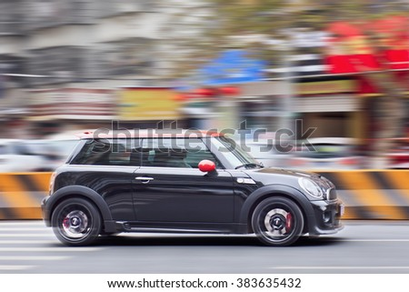 YIWU-CHINA-JAN. 2016. Black Mini Cooper. Despite Mini sales rose 17.8% in 2015, BMW will face a drop in China as luxury products are hit by economic woes and authorities combat bribery and corruption. - stock photo
