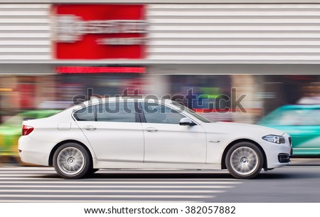 YIWU-CHINA-JAN. 15, 2016. BMW 5 series on the road. BMW's China sales dropped 4%, first decline in in a decade. BMW dealers in China discounting their vehicles by as much as 25-35% to move products. - stock photo