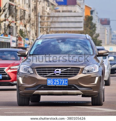 YIWU-CHINA-JAN. 26, 2016. Volvo XC60 AWD front view. The Swedish manufacturer, bought by Zhejiang Geely in 2010, is beginning to reap benefits of five-year, $11 billion plan to develop new models.  - stock photo