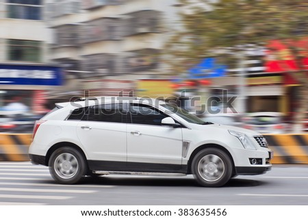 YIWU-CHINA-JANUARY 20, 2016. Cadillac SRX SUV. Despite slowing sales in China, General Motors is doubling down on the country with a bold expansion plan that could make it Cadillac's biggest market. - stock photo