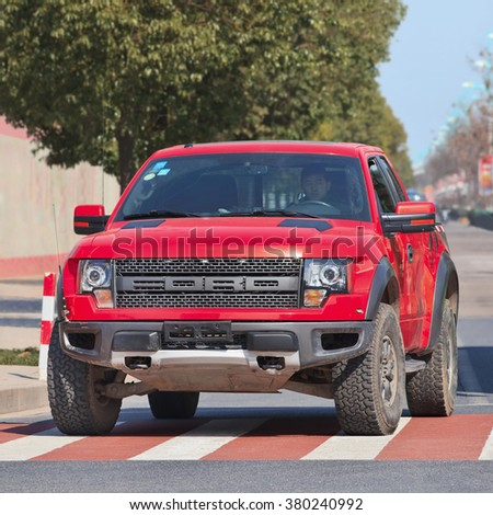 YIWU-CHINA-JANUARY 26, 2016. Ford F-150 SVT Raptor Special Edition. Ford set a sales record in China in 2015 as annual sales of Ford vehicles reached 1,115,124, up three percent compared to 2014. - stock photo