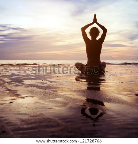 yoga at sunset - stock photo