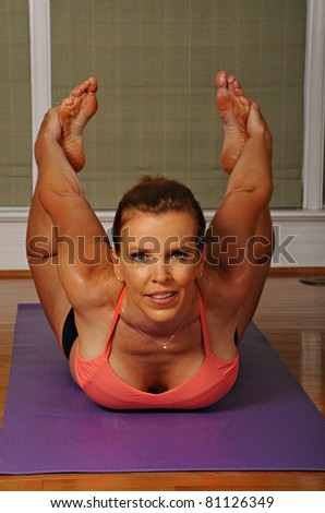 Yoga Bow Pose by Woman - stock photo