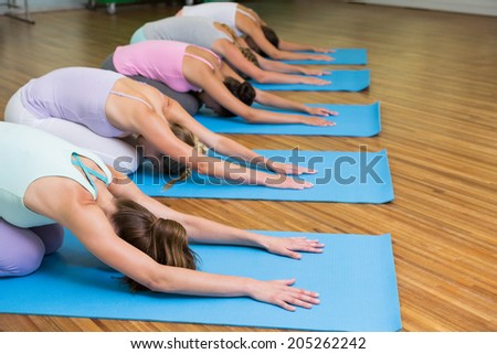 Yoga class in childs pose in fitness studio at the leisure center - stock photo
