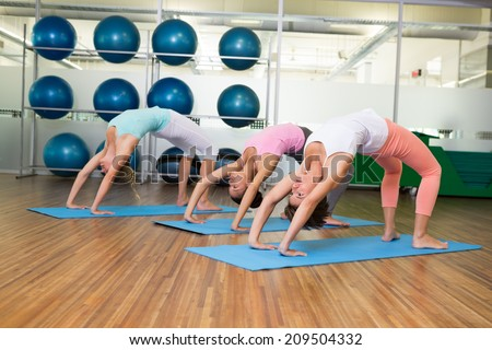 Yoga class in crab pose in fitness studio at the leisure center