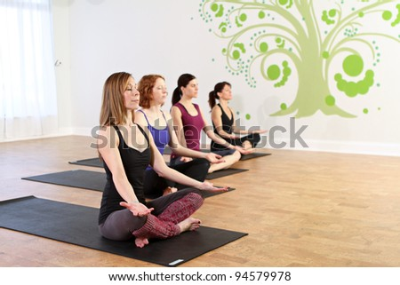 Yoga class is in session - stock photo