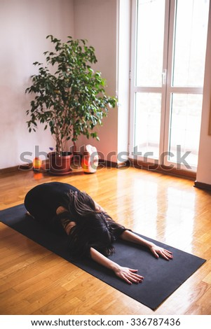 Yoga Class young woman Relaxing and Doing Yoga. Child's Pose. Wellness and Healthy Lifestyle - stock photo