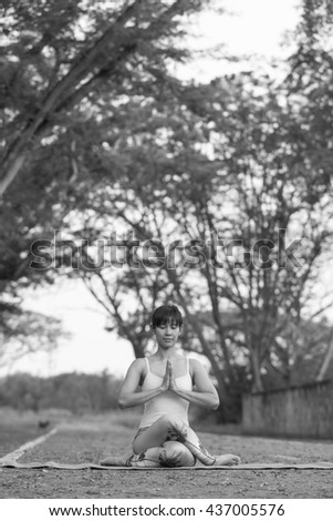 Yoga for Health And to better shape . This image is a black and white portrait .