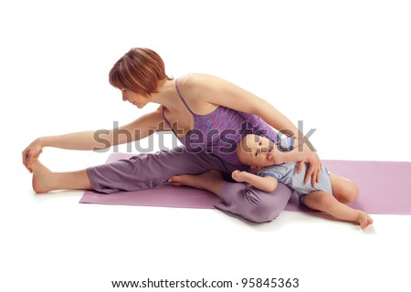 Yoga for woman and child / Mother with the baby boy doing Yoga stretch exercises