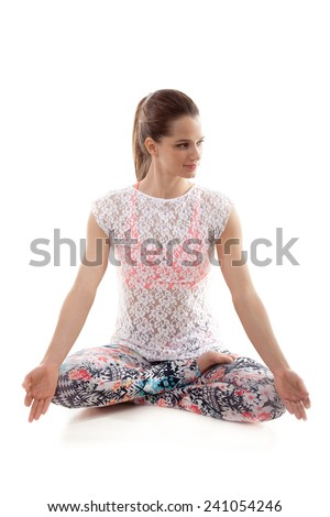 Yoga girl on white background in lotus posture with fingers in yogic gesture Chin Mudra - stock photo